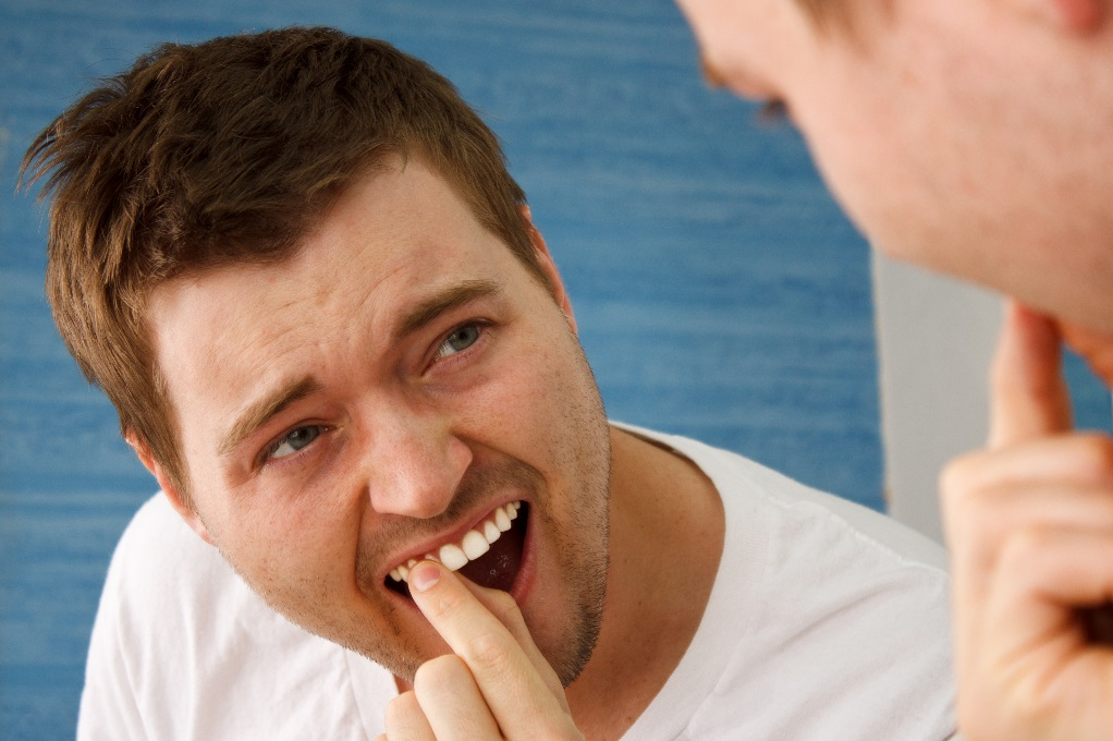Man with Loose Tooth